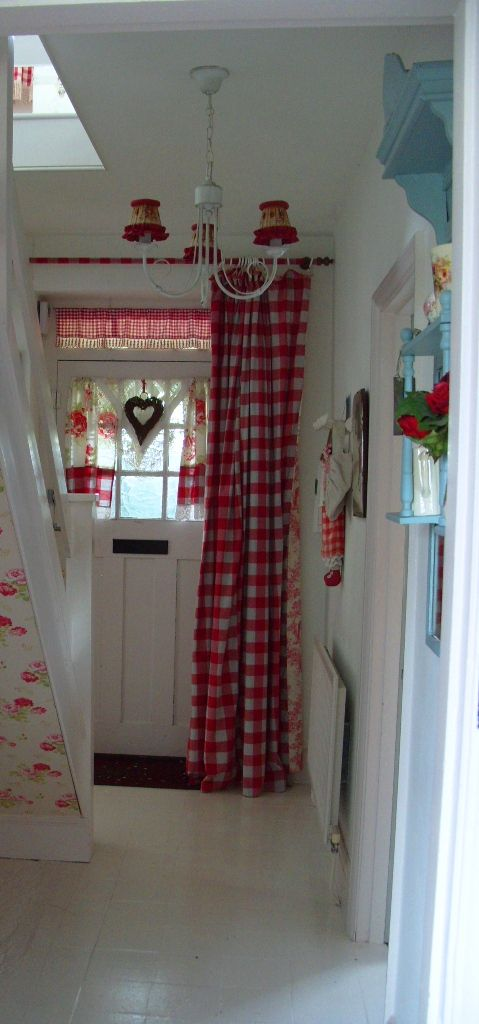White hall with red gingham and Cath Kidston wallpaper