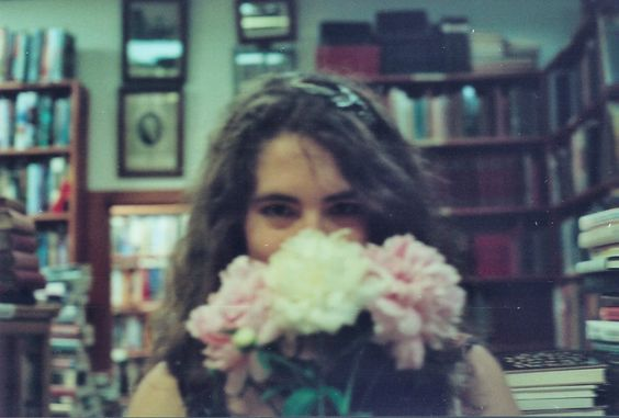 On my film camera in an old book store with some peonies :)