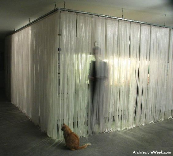 A curtain of translucent plastic strips acts as a mosquito barrier ...