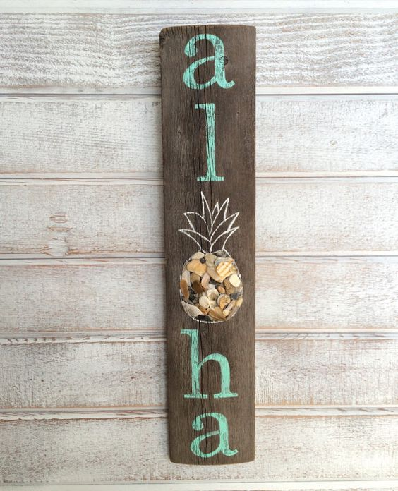 This sign measures 16 inches long, 3 3/8 inches wide, and 1/2 inch thick at the thickest part