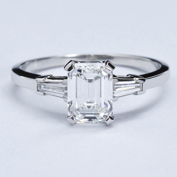 Baguette accent diamond engagement ring