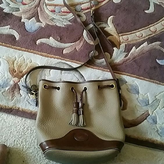 Dooney and bourke bag Authentic all weather leather dooney and bourke bag in good condition has a little scratches Dooney & Bourke Bags