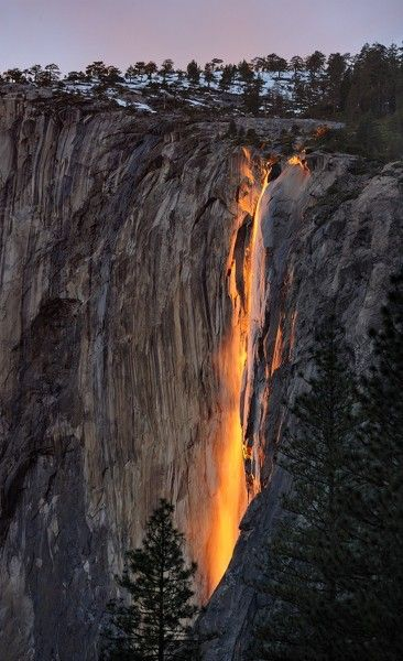 every year, for a few days during the month of february, the suns angle is such that it lights up horsetail falls in yosemite as if it were on fire.: