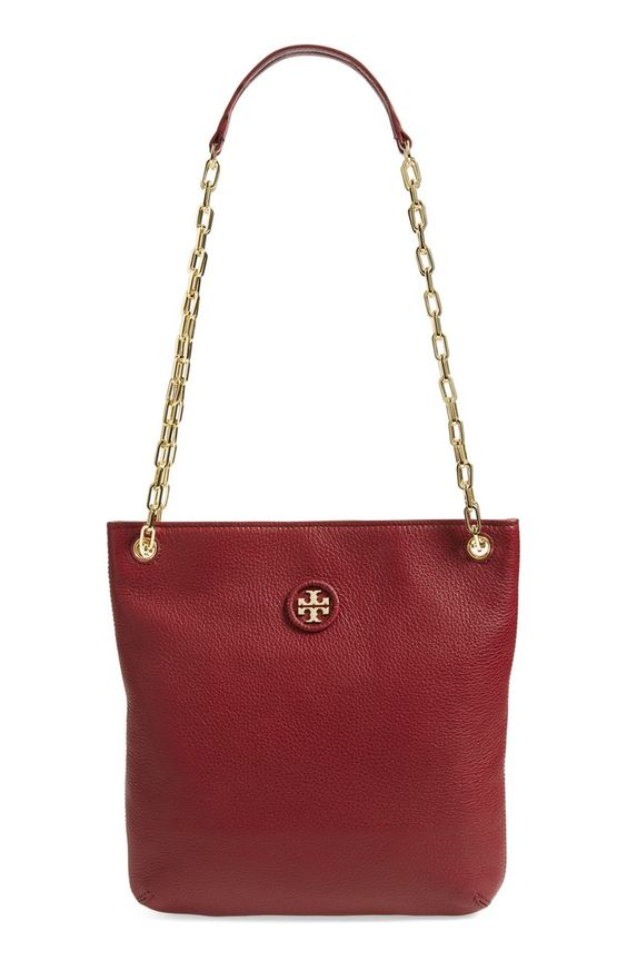Whipstitched trim highlights the goldtone logo medallion of this timeless pebbled-leather tote from Tory Burch. A must from the NSale!