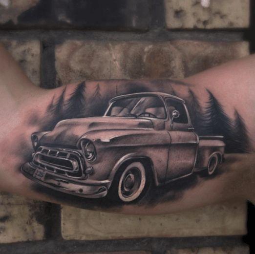 Black and grey truck tattoo