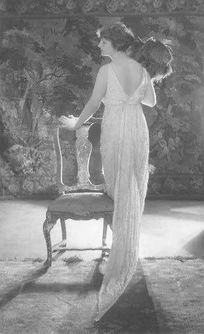 c.1921 Baron de Meyer ,Swedish Actress Martha Hedman  Actress Martha Hedman wearing a sleeveless beaded dress with white charmeuse lining and deep V-back, by Bendel.