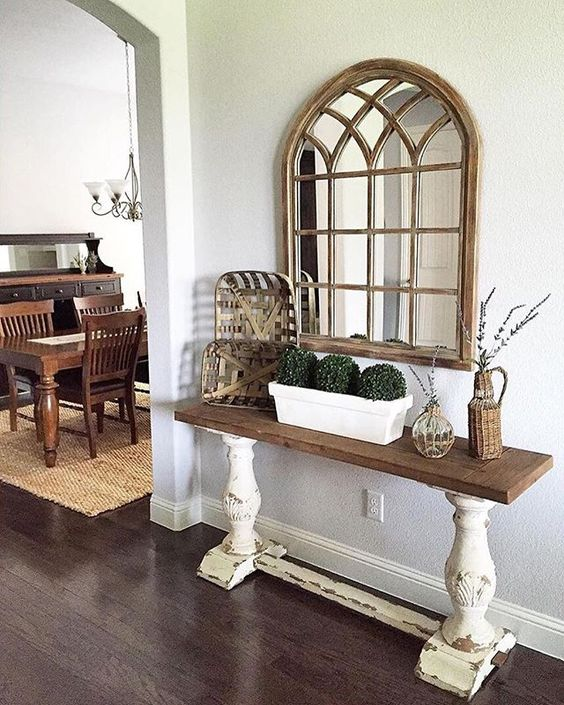 @greyjuniper sure does love #wooddecor, and our Natural Sadie Arch Mirror matches so well. She does a great job of incorporating rustic and natural tones and style in her #entryway! If you love this mirror too, then click the link in our profile to shop! #myKirklands #walldecor #mirrors #instahome