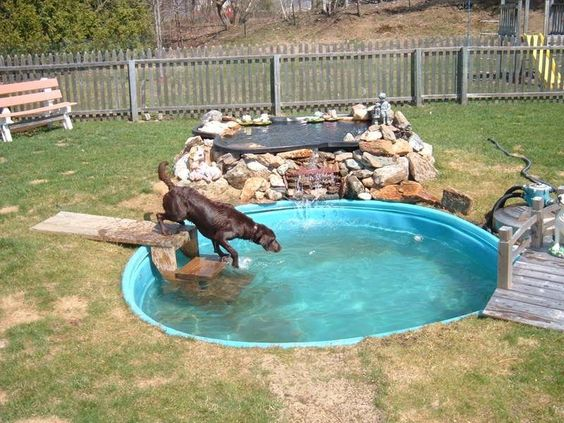 This is a cute way to make any old pool look really unique in your backyard. With just a bit of stonework and a bridge you've got a waterfall and your dog has a fun pool.
