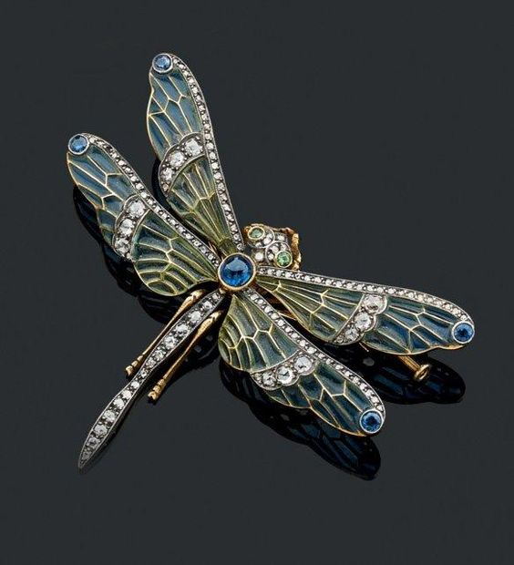 Trembleuse beautiful brooch gold and silver, representing a dragonfly, the