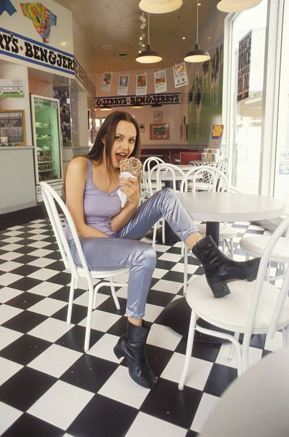 Angelina Jolie at age 19 in a camisole, silk skinny pants, and black '90s boots