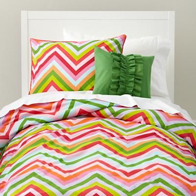 Our Watermelon Stripes Bedding is the starting point of the room. With bright saturated hues and a bold chevron print, it's sure to make for one happy big girl room!