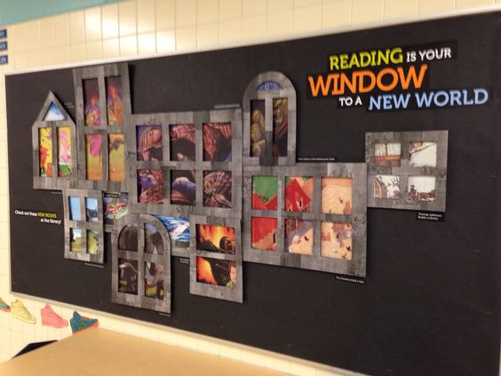 """Book Display: """"Reading is your window to a new world."""" (The book covers are displayed through a variety of window shapes.)"""