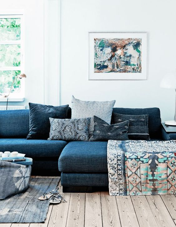 indigo sofa with patterns on top: