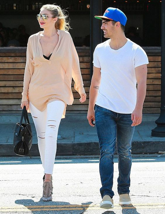 gigi-hadid-joe-jonas-street-style-couple-destroyed-jeans-white-pants
