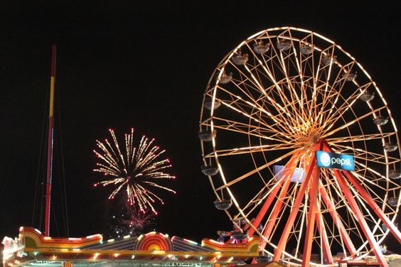 Fireworks on the beach are a backdrop for the Jolly Roger Amusement park in Ocean City, Maryland
