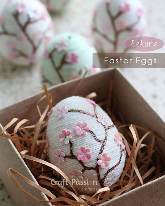 Turn your eggs into flowering cherry blossom trees with yarn and pink sequins.: