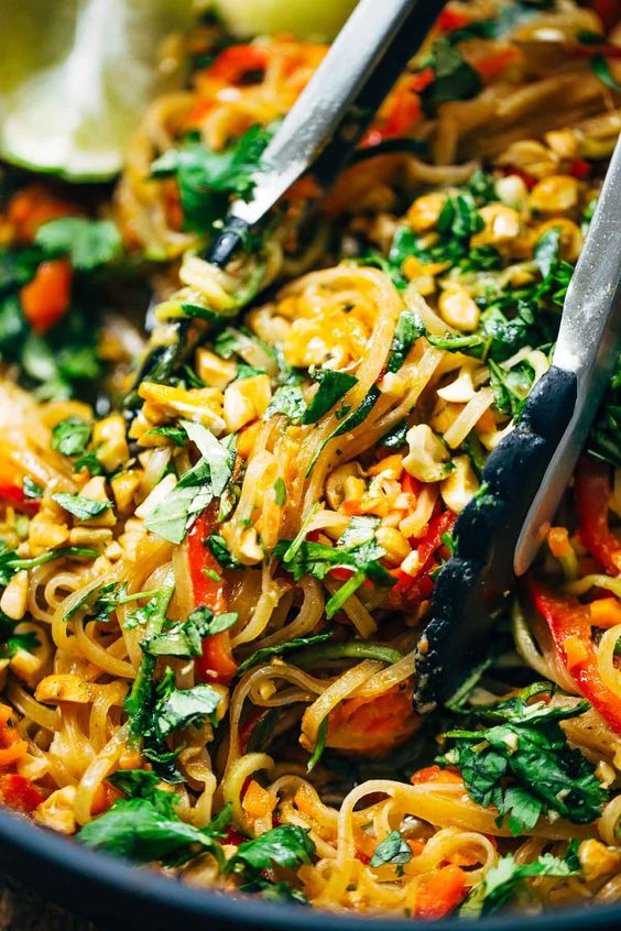 Rainbow Vegetarian Pad Thai - a fast and easy recipe that's adaptable to whatever veggies or protein you have on hand, with a simple 5-ingredient Pad Thai sauce that you just shake up in a jar! 370 calories. | pinchofyum.com