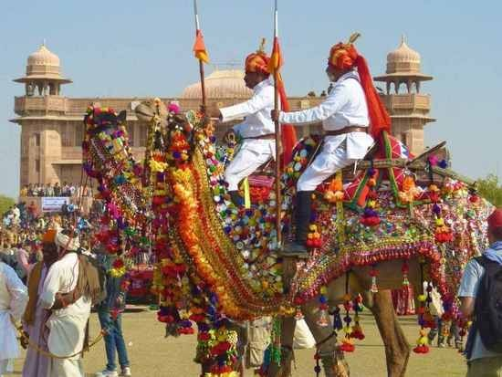 India's Republic Day Parade scene. There  are decorated camels and elephants  besides soldiers, and colorful dances from every state of India.