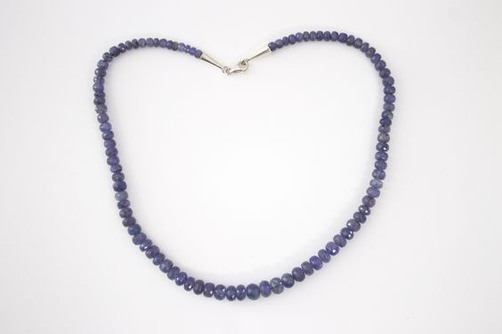 Tanzanite faceted Necklace with sterling silver cone caps. Tanzanite is a periwinkle blue color.