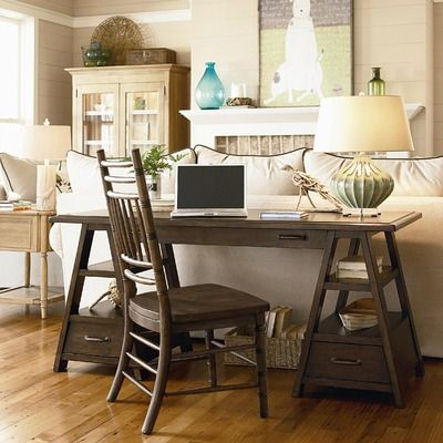 I love the idea of putting a long desk like this where a relatively useless sofa table would normally sit.: