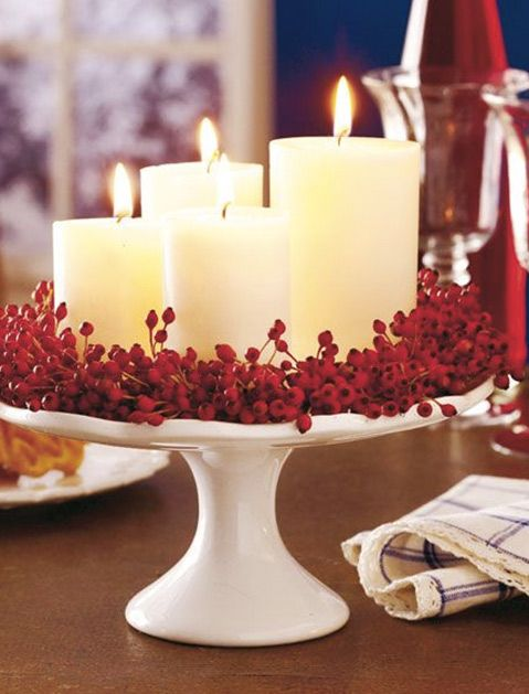 Go for wreaths on a cake stand surrounded by candles./ 20 Christmas Decorating Ideas We Bet You Haven't Thought Of via @PureWow