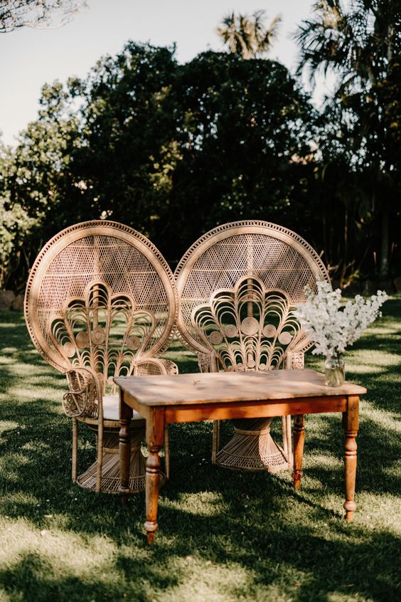Sophisticated wicker chairs for the couple's table at this Australian reception | Image by Zoe Morley