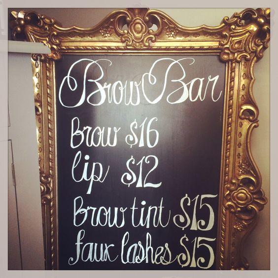 Treatment menu on blackboard in ornate frame