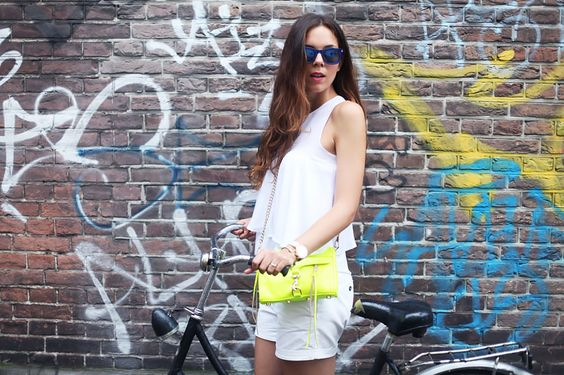 All white with a colour pop bag by Rebecca Minkoff
