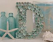 limpet shells on letter..Great to do your child's initial in sea shells..58.00 a letter..so one may look good!