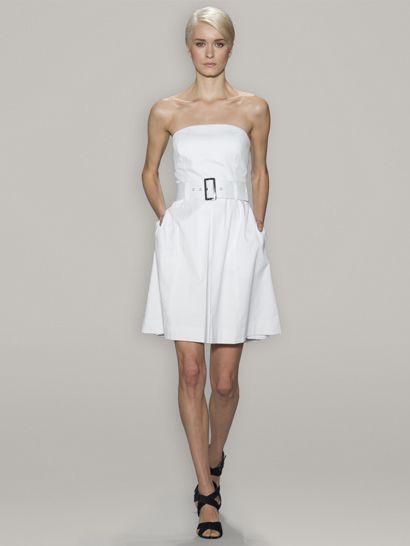 White dress, cropped hair