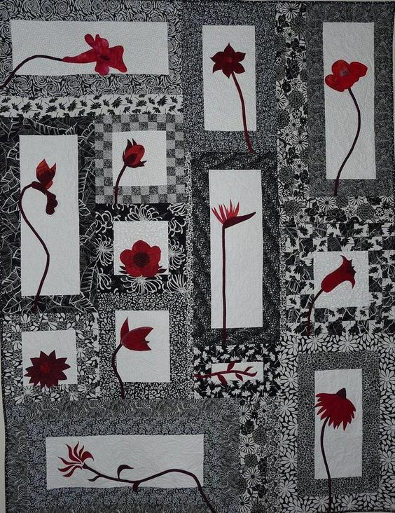 Meets a lot of my goals in quilting... Black and White with Red pops of color.: