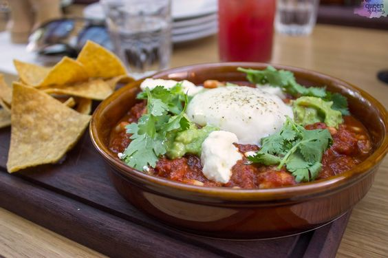 Asado: tomato adobo with slow egg, beans, labne, guacamole and tortilla chips