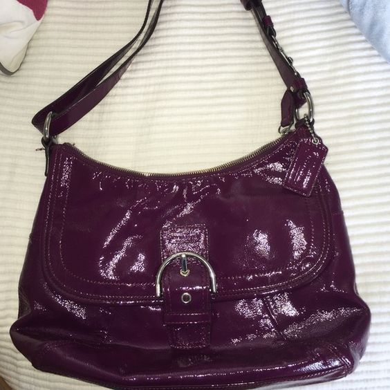 100% real Coach purse Coach Lynn Soho Scarf Print shoulder bag! Its in great condition inside and out. The interior is lined with a purple satin and has 3 separated compartments to keep you organized. Has shiny purple glossy tone hardware and a Coach hang tag attached Coach Bags Totes