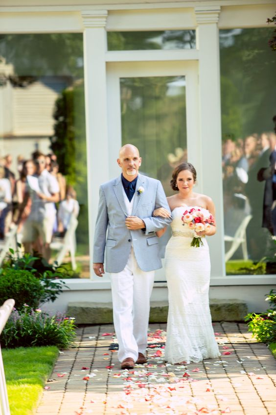 Such a #beautifulimage of the #bride #walkingdowntheaisle with the #fatherofthebride + the #reflection of the #weddingguests in the windows. ::Jordan + Michael's cheerful outdoor wedding at Cloverleaf Farms in Arnoldsville, Georgia:: #cloverleafweddings #cloverleaffarms #weddingday #weddingceremony #georgiawedding