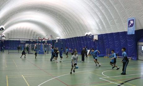 A sports class inside the inflatable clean-air dome at the British School of Beijing. - Provided by Guardian News