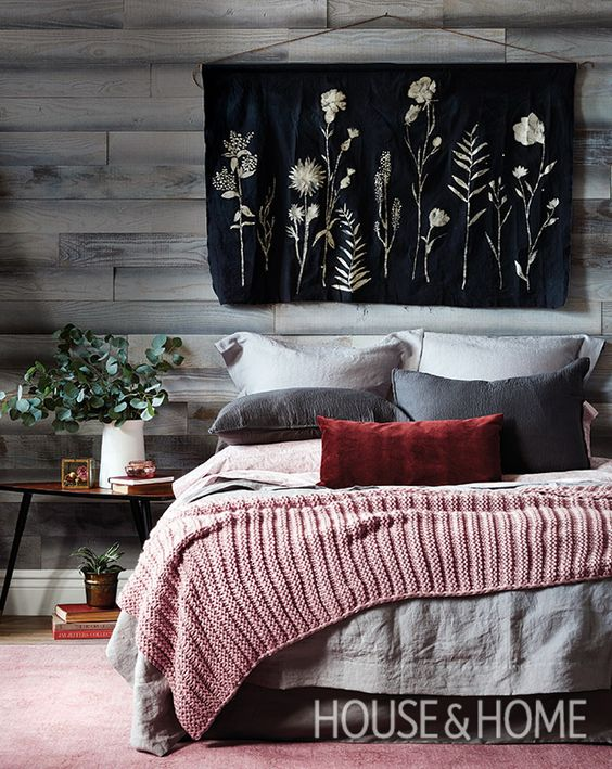 Leave it to H&H's assistant design editor Jen Koper to craft the perfect wall hanging for this bedroom. To complete the cabin feel, Jen layered the bed with cozy linens and added wood wall paneling behind. | Photographer: Donna Griffith | Designer: Jen Koper: