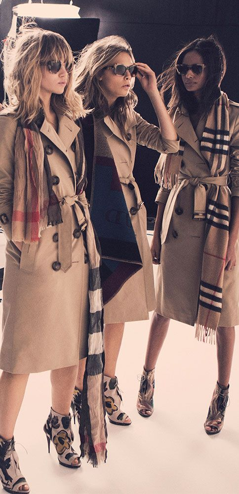 On set of the Autumn/Winter 2014 campaign Suki, Cara and Malaika in Heritage trench coats, check blanket ponchos and cashmere scarves