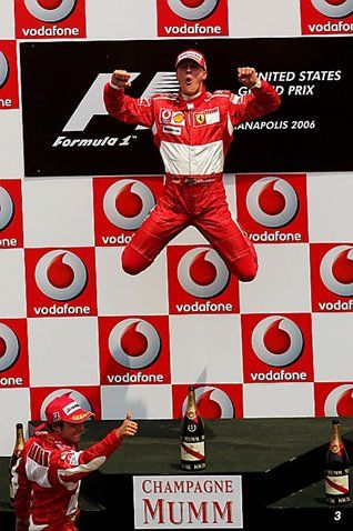Race winner Michael Schumacher (GER) Ferrari celebrates on the podium.  Formula One World Championship, Rd 10, United States Grand Prix, Race, Indianapolis, USA, 2 July 2006