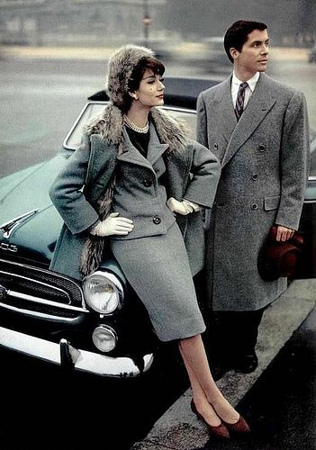 Simone in Jean Patou and gentlemen's coat by Max Evzeline, car is a Peugeot convertible grand luxe 403, Paris 1957