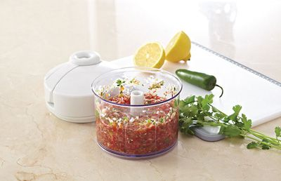 Fresh Tomato Salsa.   1 small onion, 1 jalapeño pepper, stemmed, 1/2 cup loosely packed fresh cilantro, 2 tbsp fresh lemon juice,   2 garlic cloves, peeled, 1/2 tsp salt  2 cups grape tomatoes          ©2012 The Pampered Chef used under license.
