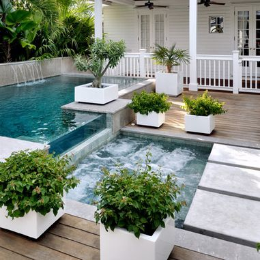 The top pool is somewhat small on its own, but the little one is definitely smaller but still has a great option, a hot tub. Who wouldn't love a great hot tub on their porch, right next to their own personal pool and waterfall?