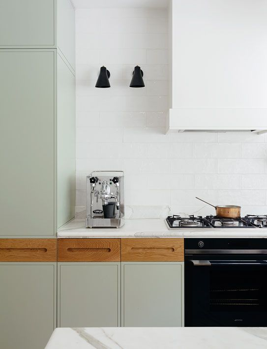 Nice to see a bespoke detail to kitchen units. The drawers are in a warm oak with inset handle. The colour of the oak is always a winner with duck egg blue / green tones. Black hood in white blends in nicely with the white tiles - and I'm a huge fan of not using wall units where possible. Black details finish it off perfectly.