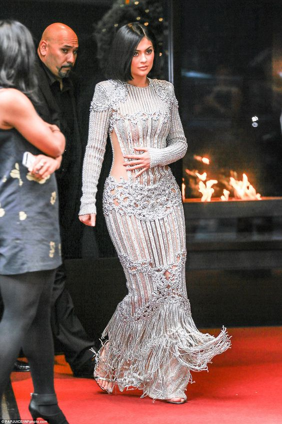 Time to dazzle: Kylie Jenner arrived in a sheer silver gown that revealed portions of her torso and legs