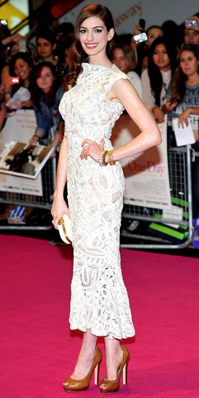 Anne Hathaway greeted fans at the London premiere of One Day in an Alexander McQueen sheath accessorized with the labels skull clutch and whipstitch peep-toes along with more than $100,000 of Tiffany & Co. jewelry.