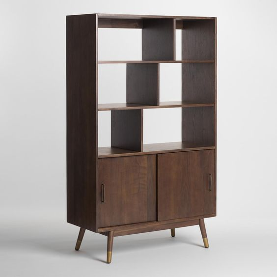 With a classic walnut brown finish, flared, gold-tipped legs and slim, tapered cabinet handles, our wooden bookshelf boasts iconic mid-century style. A mix of exposed and hidden shelving offers display space for photos and souvenirs, as well as storage for books, office supplies and more.