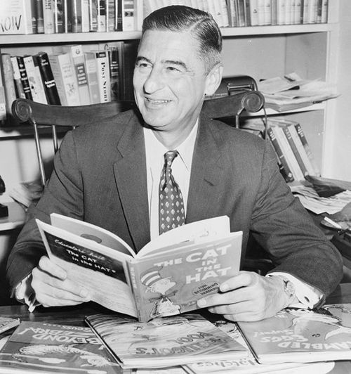 Ted Geisel (Dr. Seuss) half-length portrait, seated at desk covered with his books / World Telegram & Sun photo by Al Ravenna. 1957.  Library of Congress Prints and Photographs Division. New York World-Telegram and the Sun Newspaper Photograph Collection. http://hdl.loc.gov/loc.pnp/cph.3c16956