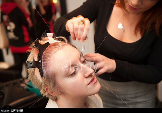 A young woman in a salon. © Keith Morris / Alamy