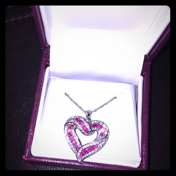 Brand new diamond pendant Received as a gift but never wore. I would rather someone who will actually wear it have it. Never been taken out of the box. Helzburg Jewelry Necklaces