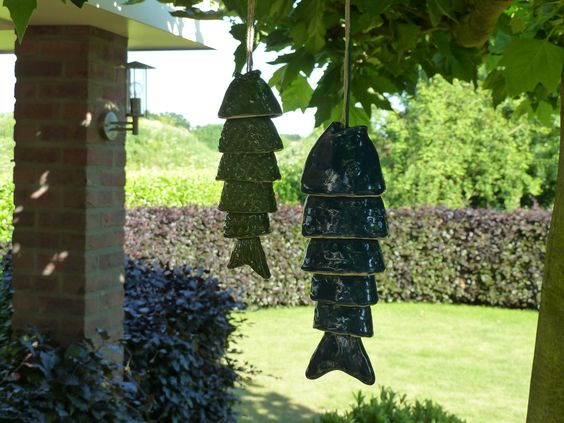 Koi van and porcelain on pinterest for Colored porcelain koi fish wind chime