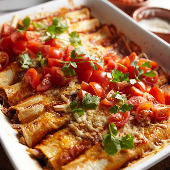 These savory Pulled Pork Enchiladas are a flavor-packed slow cooker dinner. Plus, get 20 more Mexican dishes you can make in your slow cooker!